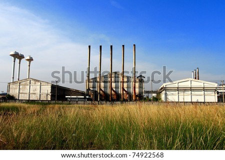 Factory and green meadow