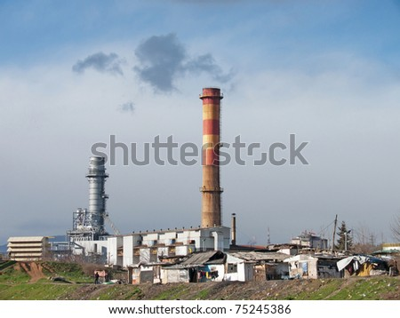 Factory and poor housing - stock photo
