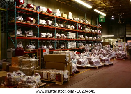 Factory assembled products wait in the Shipping & Receiving Area. - stock photo