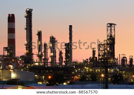Factory at orange twilight - stock photo