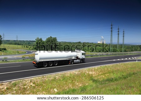 Factory behind motorway - stock photo