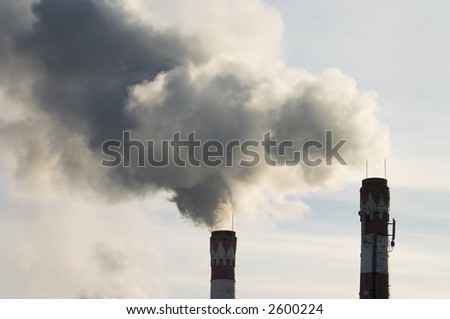 Factory chimney with gas puffs