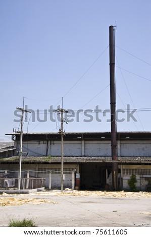 factory door and smokestack - stock photo