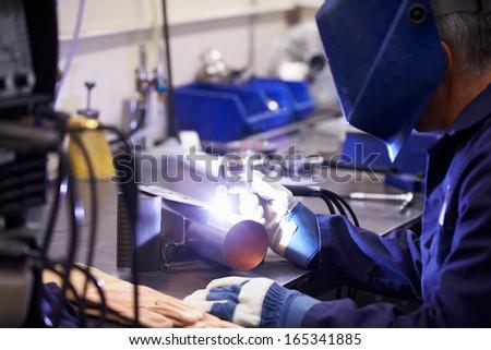 Factory Engineer Operating TIG Welding Machine - stock photo
