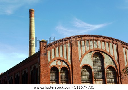 factory floor and smokestack in old gasworks, Poznan, Poland
