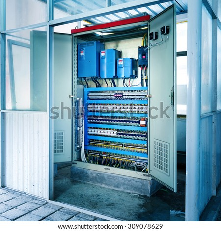 Factory floor, automated machinery control room. - stock photo