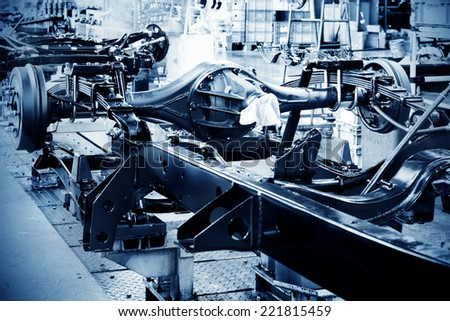 Factory floor, pickup truck production lines. - stock photo