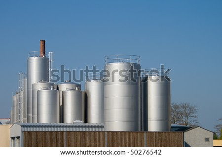 Factory for Industrial Manufacturing. Storage towers at dairy plant.