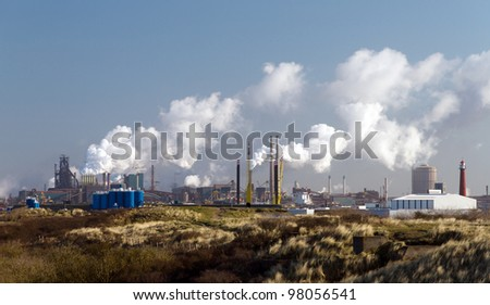 Factory in the dunes - stock photo