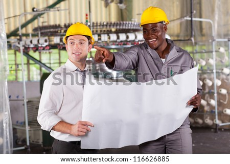 factory manager and worker discussing about production plan - stock photo