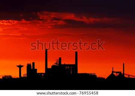 Factory on a purple sunset background
