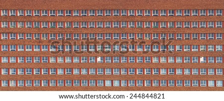 factory or office building with red brick wall - stock photo