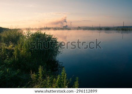 Factory pipe polluting air. Environmental problems background - stock photo