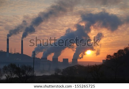 Factory pipe polluting air, environmental problems, ecology theme, the smoke from the chimneys - stock photo
