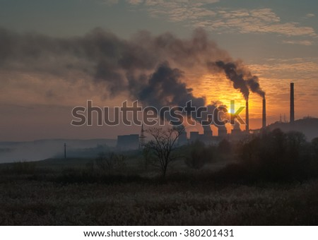 Factory pipe polluting air, smoke fron chimneys against sunset, environmental problems - stock photo
