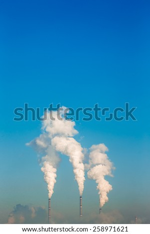 Factory pipe polluting fresh air, environmental problems. Global warming - stock photo
