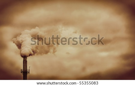 Factory pipe smoke pollution with orange sky - stock photo