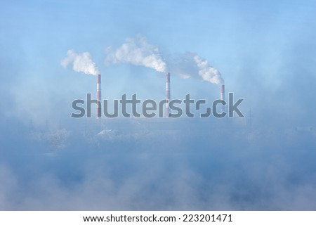 Factory pipes polluting air, environmental problems - stock photo