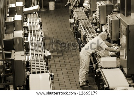 Factory production line in Oregon cheese factory - stock photo