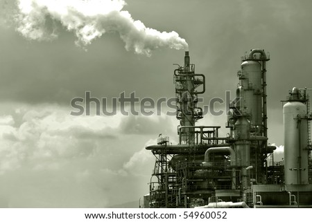 factory releasing pollution smoke from its waste - stock photo