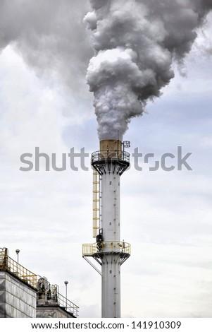 Factory smokestack - stock photo
