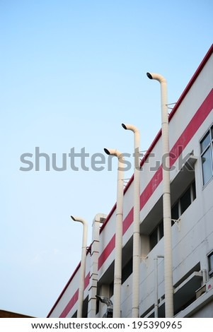 Factory smokestacks on the clear sky day - stock photo