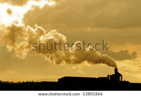 Factory spewing out pollution - stock photo