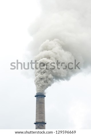 Factory stack with dense smoke - stock photo
