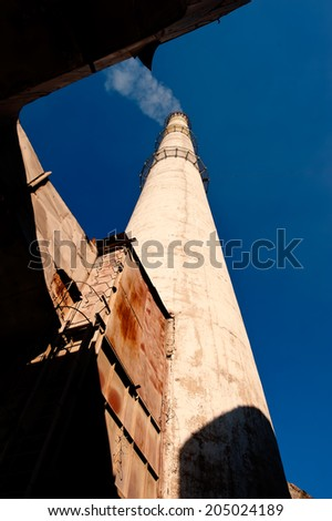 factory vapor pipe on blue sky background - stock photo