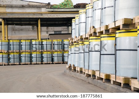 Factory warehouse with steel sheet rolls - stock photo