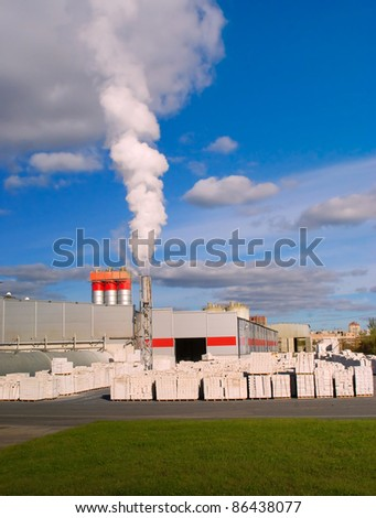 Factory with a chimney and white smoke