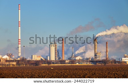Factory with air pollution - stock photo