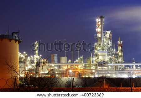 Factory with air pollution, Oil industry - stock photo