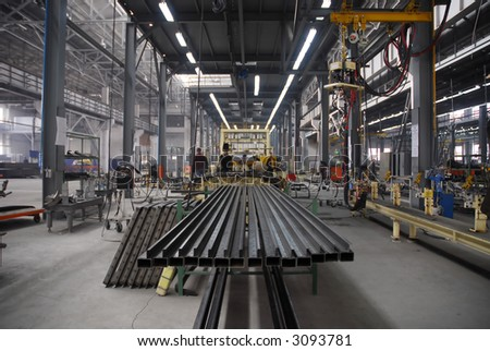 Factory with people and active production - stock photo