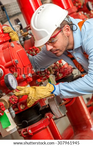 Factory Worker with protective equipment - stock photo