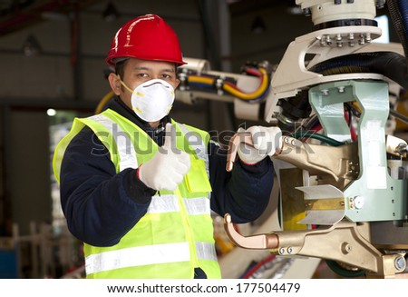 Factory worker with robot machine - stock photo