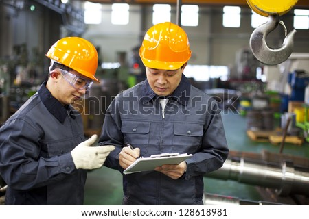 Factory workers discussion inspection report