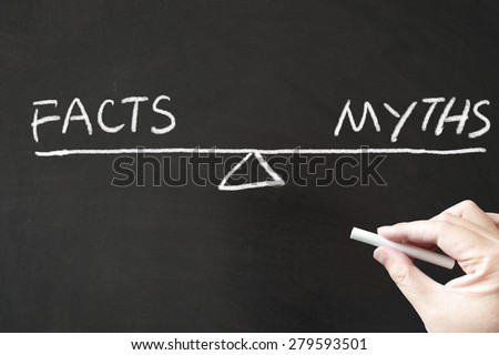 Facts vs Myths words written on the blackboard using chalk - stock photo