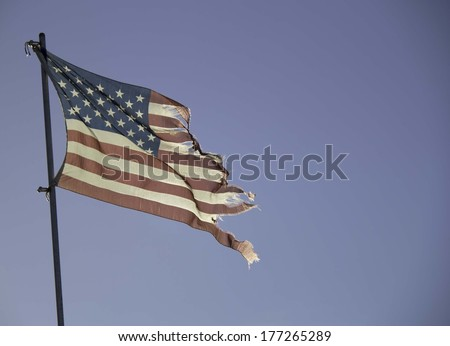 Faded and Tattered American Flag - stock photo