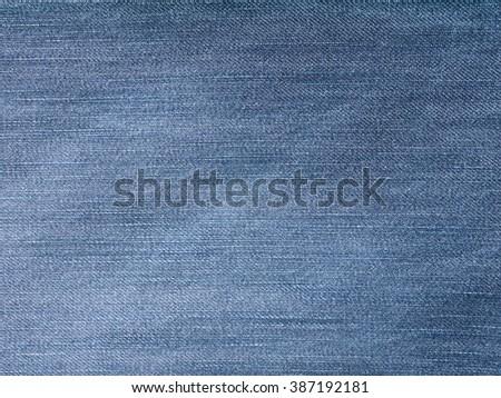 Faded medium blue jeans denim material background - stock photo