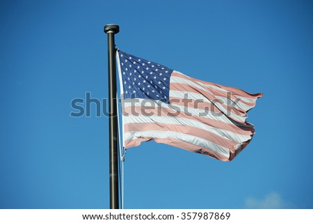 faded USA flag waving in the wind