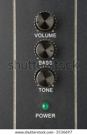 faders volume bass tone and power lamp - stock photo