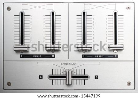 fading controls of dj music mixer closeup - stock photo