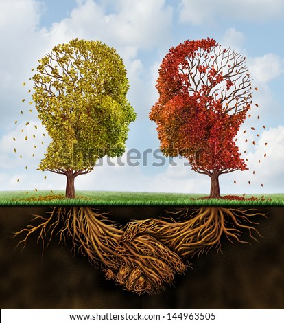 Fading team business concept as two autumn trees losing leaves in the shape of human heads with roots underground shaped as shaking hands as a team agreement that is losing strength on a summer sky. - stock photo