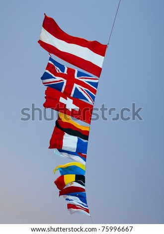 fags of various European countries against the blue sky - stock photo