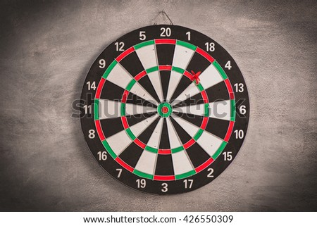fail target aim, red plastic tip dart fail on darts target - stock photo