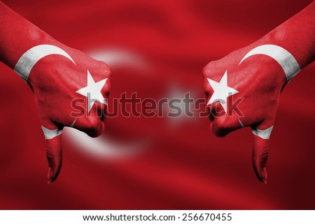 failure of Turkey - hands gesturing thumbs down in front of flag