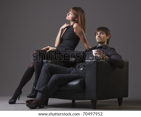 failure relationship - proud man with cup coffee and sad woman - stock photo