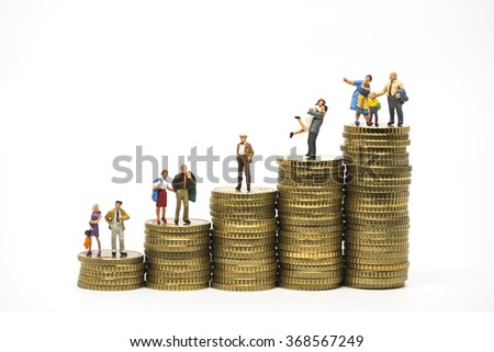 Faily budget concept. Miniature family on coins pile. Macro photo - stock photo