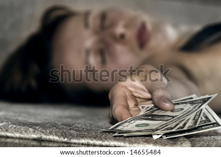 fainting woman lying on the floor,money in the hand - stock photo